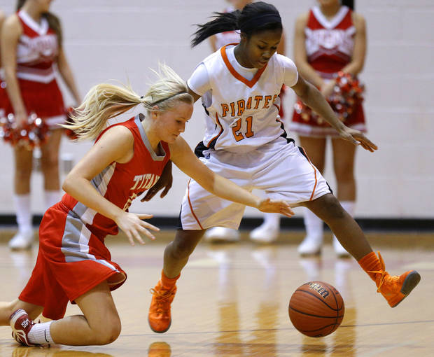 Carl Albert's Asher Sutterfield, left, and Putnam City's Jamee Moore go for the ball during their girls high school basketball game at Carl ALbert in Midwest City, Okla., Friday, Jan. 25, 2013. Photo by Bryan Terry, The Oklahoman
