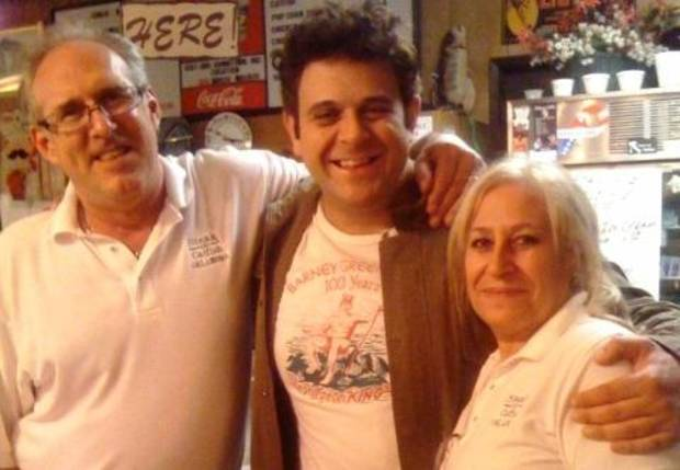 """Man v. Food"" host Adam Richman flanked by Steak and Catfish Barn owners Dino Smalley and Maria Vitale after a recent shoot for Richman's show, which airs on the Travel Channel."