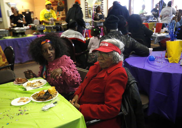 Eulila Davis, right, and Brenda Davis eat during the Soul Food Festival at Grace Living Center.