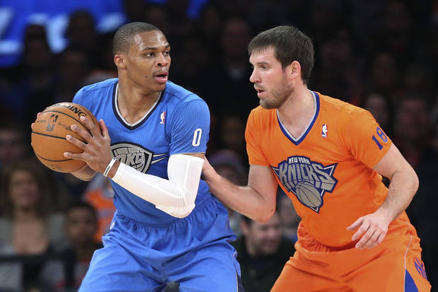 Oklahoma City Thunder point guard Russell Westbrook (0) looks to pass around New York Knicks point guard Beno Udrih (18) during the first half of an NBA basketball game at Madison Square Garden, Wednesday, Dec. 25, 2013, in New York. The Thunder won 123-94. (AP Photo/John Minchillo)