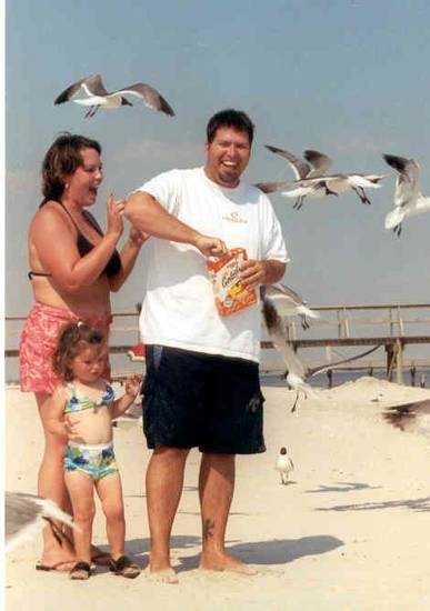 Jason Bartlett and his wife Jaime and daughter Caeli Rose, stand on a beach. Bartlett was killed by lightning 10 years ago and his life will be celebrated this weekend on Lake Eufaula. Photo provided <strong>PROVIDED</strong>