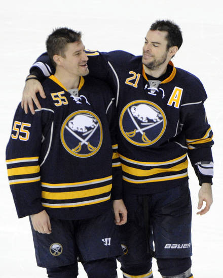 Buffalo Sabres' Jochen Hecht (55), of Germany, celebrates with Drew Stafford (21) after an NHL hockey game against the New York Islanders' in Buffalo, N.Y., Friday, April 26, 2013.  Buffalo won, 2-1. (AP Photo/Gary Wiepert)