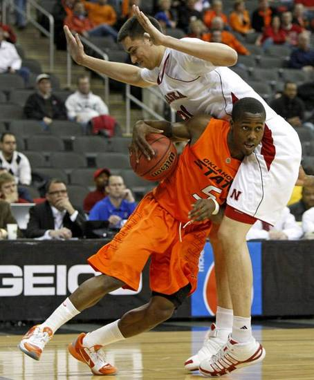 OKLAHOMA STATE UNIVERSITY / OSU: Oklahoma State's Reger Dowell (5) tries to get past Nebraska's Jorge Brian Diaz during the college basketball Big 12 Championship tournament game between Oklahoma State and Nebraska in Kansas City, Mo., Wednesday, March 9, 2011.  Photo by Bryan Terry, The Oklahoman     ORG XMIT: KOD
