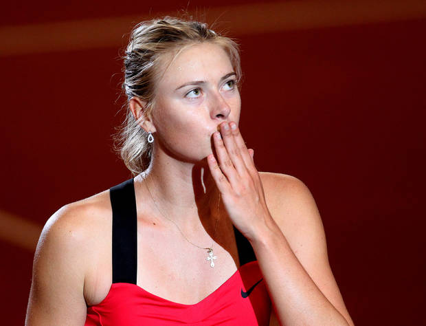 Russia's Maria Sharapova blows a kiss after beating Australian Samantha Stosur 6-7, 7-6, 7-6 during their quarterfinal match at the Porsche tennis Grand Prix in Stuttgart, Germany, Friday, April 27, 2012.  (AP Photo/Michael Probst) ORG XMIT: PSTU126