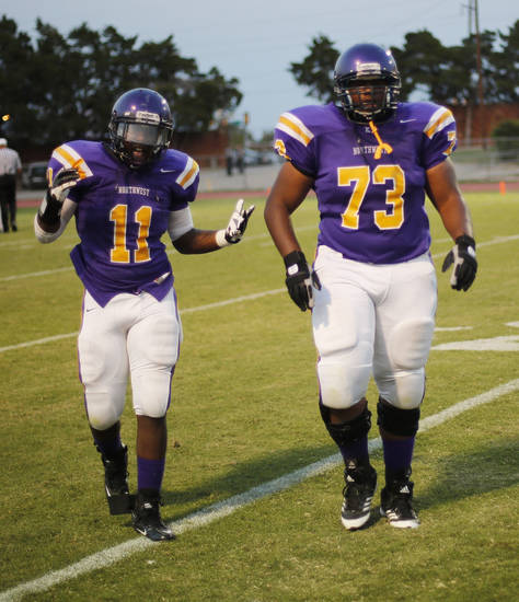 Isiah Beverly (11) comes off field after a touchdown with Terrance Lowery (73) at the Northwest Classen vs. Western Heights high school football game at Taft Stadium Thursday, September 20, 2012. Photo by Doug Hoke, The Oklahoman