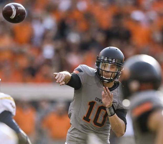 Oklahoma State quarterback Clint Chelf throws a pass during the second half of an NCAA college football game against West Virginia in Stillwater, Okla., Saturday, Nov. 10, 2012. Chelf threw for 292 yards and four touchdowns as Oklahoma State won 55-34.. (AP Photo/Brody Schmidt)