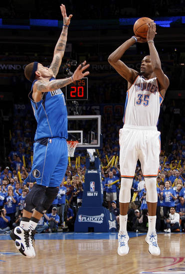 Oklahoma City's Kevin Durant (35) shoots against Dallas' Delonte West (13) during game one of the first round in the NBA playoffs between the Oklahoma City Thunder and the Dallas Mavericks at Chesapeake Energy Arena in Oklahoma City, Saturday, April 28, 2012. Oklahoma City won, 99-98. Photo by Nate Billings, The Oklahoman