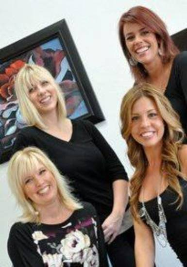 Michelle Wilson, left, and Kim Turner, bottom row. Callie Held and Lannie Cook, Wilson Art Hair Gallery.