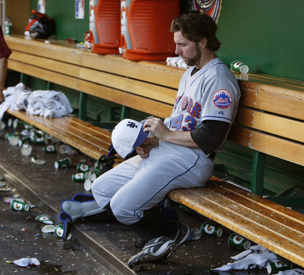 New York Mets starting pitcher R.A. Dickey sits alone in the dugout following his team's 6-5 loss to the Washington Nationals in a baseball game in Washington, Saturday, July 3, 2010.  (AP Photo/Ann Heisenfelt) ORG XMIT: NAT113