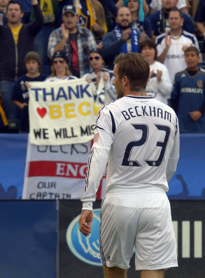 Los Angeles Galaxy midfielder David Beckham looks on as fans hold up a sign thanking him during the second half of an MLS Cup soccer match against the Houston Dynamo, Saturday, Dec. 1, 2012, in Carson, Calif. The Galaxy won 3-1. (AP Photo/Mark J. Terrill)
