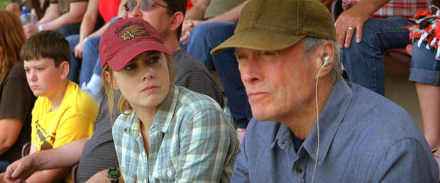 "Clint Eastwood and Amy Adams play a father and daughter weathering a stormy relationship in ""Trouble with the Curve."" WARNER BROS. PHOTO <strong></strong>"