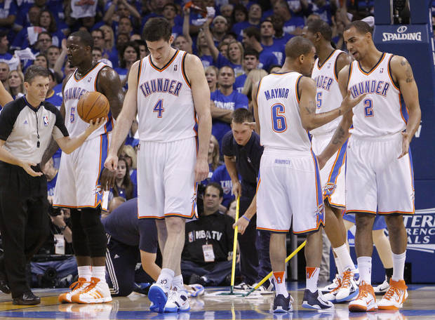 OKLAHOMA CITY ARENA / REACTION: The Thunder players react after Oklahoma City&#039;s Nick Collison (4) was called for a foul during game 3 of the Western Conference Finals of the NBA basketball playoffs between the Dallas Mavericks and the Oklahoma City Thunder at the OKC Arena in downtown Oklahoma City, Saturday, May 21, 2011. Photo by Chris Landsberger, The Oklahoman ORG XMIT: KOD