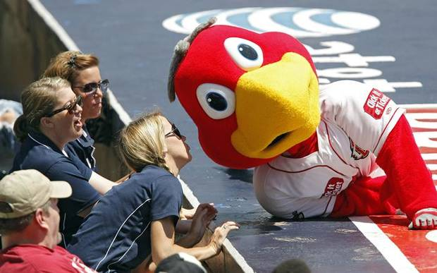 MINOR LEAGUE BASEBALL / MASCOT: Rowdy gets a kiss from one of the RedHawks' staff during the Oklahoma City RedHawks game against New Orleans on Tuesday, June 15, 2010, in Oklahoma City, Okla.  Photo by Chris Landsberger, The Oklahoman ORG XMIT: KOD