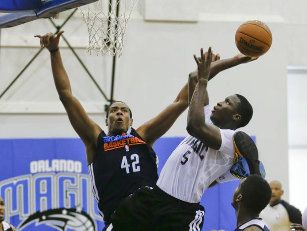 Orlando Magic's Victor Oladipo (5) takes a shot over Oklahoma City Thunder's Ron Anderson (42) during an NBA summer league basketball game, Monday, July 8, 2013, in Orlando, Fla. (AP Photo/John Raoux) ORG XMIT: DOA107
