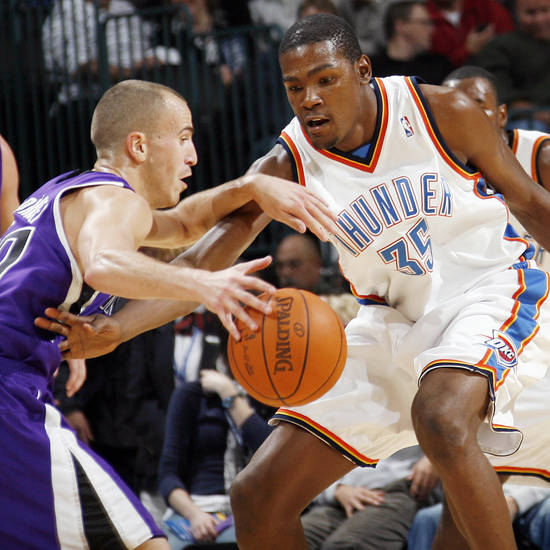Oklahoma City's Kevin Durant, right, defends Sergio Rodriguez (10) of Sacramento during the NBA preseason game between the Sacramento Kings and the Oklahoma City Thunder at the Ford Center in Oklahoma City, Thursday, Oct. 22, 2009. Photo by Nate Billings, The Oklahoman