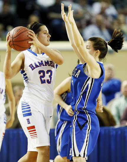Hammon's Peyton Walker (23) looks to pass the ball away from Lomega's Kylie Turner (10) during a Class B Girls semifinal game of the state high school basketball tournament between Hammon and Lomega at Jim Norick Arena, The Big House, on State Fair Park in Oklahoma City, Friday, March 1, 2013. Lomega won, 60-52. Photo by Nate Billings, The Oklahoman