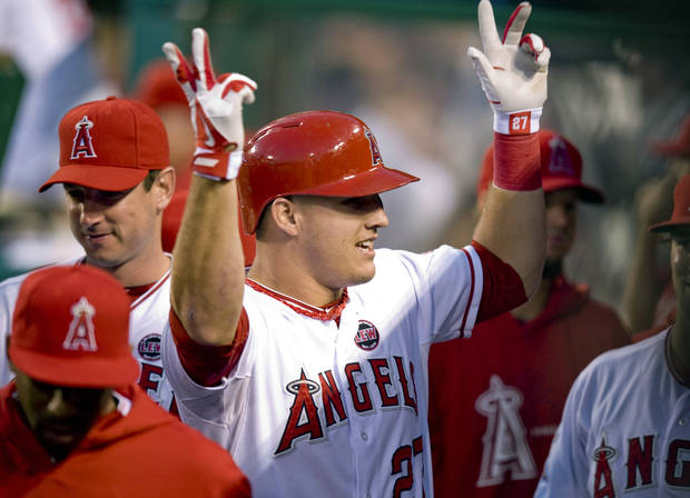 Los Angeles Angels' Mike Trout celebrates with teammates as he returns to the dugout after hitting a solo home run against the Boston Red Sox in the third inning of a baseball game, Saturday, July 6, 2013, in Anaheim, Calif. (AP Photo/The Orange County Register, Paul Rodriguez)