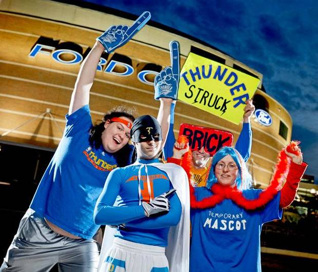 Thunder super fans, from left, Zeb Benbrook, Thunder Man, Derrick Seys, and Angela Love pose for a portrait outside the Ford Center in Oklahoma City, Thursday, Feb. 12, 2009. PHOTO BY BRYAN TERRY, THE OKLAHOMAN