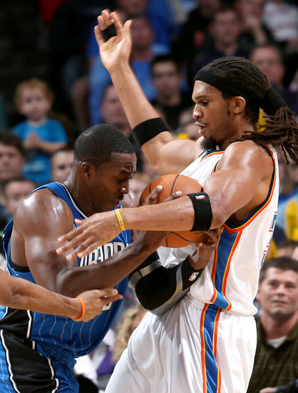 Orlando's Dwight Howard runs into pressure from OKlahoma City's Eton Thomas during the NBA basketball game between the Orlando Magic and the Oklahoma City Thunder at the Ford Center in Oklahoma City, on Sunday, Nov. 8, 2009. By John Clanton, The Oklahoman
