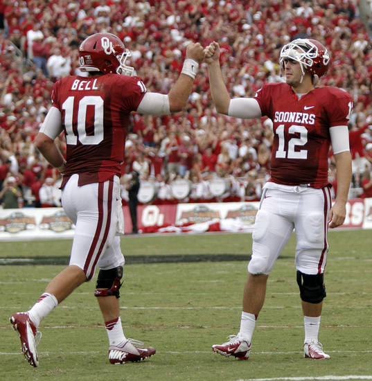 OU&#039;s Landry Jones (12) congratulates Blake Bell (10) after a touchdown during the Red River Rivalry college football game between the University of Oklahoma (OU) and the University of Texas (UT) at the Cotton Bowl in Dallas, Saturday, Oct. 13, 2012. Photo by Chris Landsberger, The Oklahoman