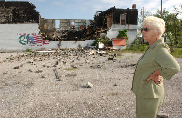 Gloria Garner, owner of the building, surveys the damage. Photo by Gary Crow, for The Oklahoman