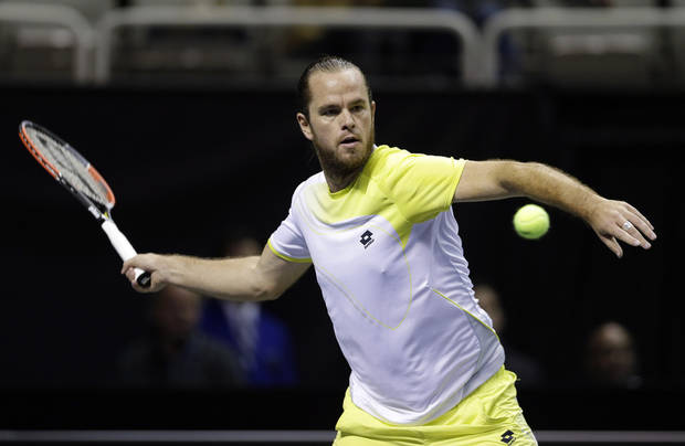 Xavier Malisse, of Belgium, returns to John Isner during the SAP Open tennis tournament in San Jose, Calif., Friday, Feb. 15, 2013. Isner won the match 7-6 (8), 6-2. (AP Photo/Marcio Jose Sanchez)
