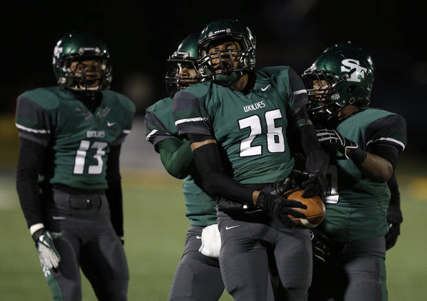 Santa Fe's Jalaun Parker (26) celebrates with his teammates during a high school football game between Edmond Memorial and Edmond Santa Fe at Wantland Stadium in Edmond, Okla., Friday, Oct. 26, 2012.  Photo by Garett Fisbeck, The Oklahoman