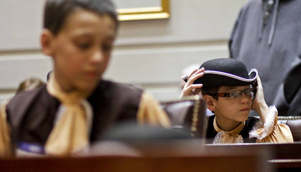 Logan Hough adjusts his hat while he sits at a desk in the Senate chamber as more than 500 fifth grade students from across the state celebrated colonial history during Colonial Day at the state Capitol on Friday, Feb. 3, 2012, in Oklahoma City, Okla. Photo by Chris Landsberger, The Oklahoman