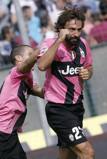 Juventus's Andrea Pirlo, right, celebrates after scoring during an Italian Serie A soccer match between Siena and Juventus, in Siena , Italy, Oct. 7, 2012. (AP Photo/Paolo Lazzeroni)