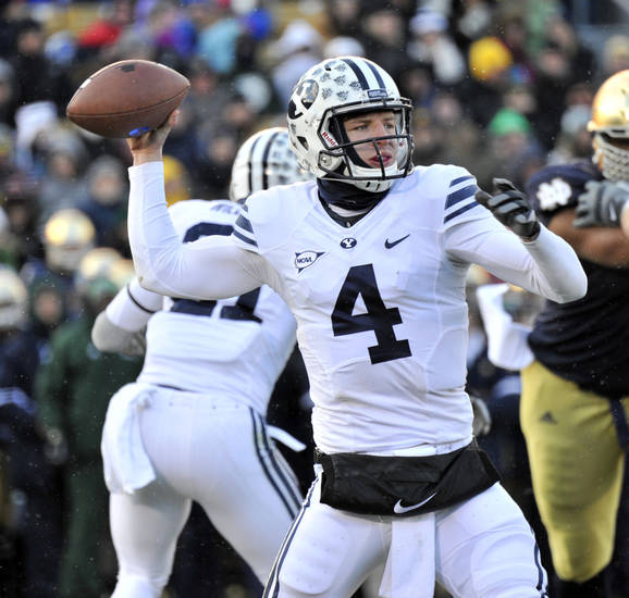Brigham Young quarterback Taysom Hill throws a pass in the first half of a game last November at Notre Dame.  (AP Photo/Joe Raymond)