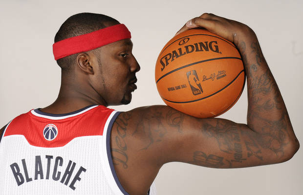 Washington Wizards' Andray Blatche poses for a photograph during NBA basketball media day, Thursday, Dec. 15, 2011, in Washington. (AP Photo/Nick Wass)