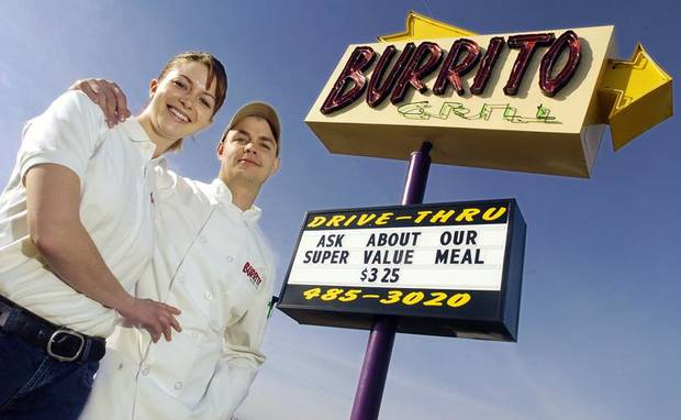 BLANCHARD, OK, TUESDAY, FEBRUARY 3, 2004. Erin and Matt Cosby stand by their sign outside of their restaurant, the Burrito Grill in Blanchard. Oklahoman staff Photo by Ty Russell.