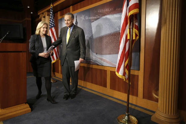 Sen. Kirsten Gillibrand, D-N.Y, left, and Sen. Charles Schumer, D-N.Y., leave a news conference on Capitol Hill in Washington, Friday, Jan. 4, 2013, where they discussed Superstorm Sandy aid. The first large aid package for victims of the deadly Superstorm Sandy started moving through the U.S. Congress on Friday, as the U.S. House of Representatives overwhelmingly approved $9.7 billion to pay flood insurance claims. A Senate vote was expected later in the day. (AP Photo/Jacquelyn Martin)