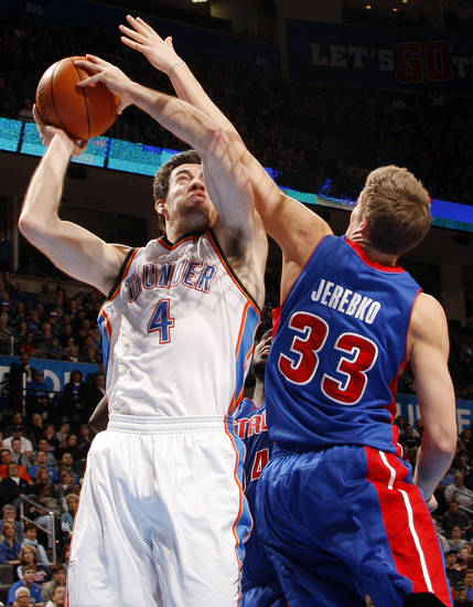 Oklahoma City's Nick Collison (4) takes the ball to the hoop as Detroit's Jonas Jerebko (33) defends during the NBA basketball game between the Detroit Pistons and Oklahoma City Thunder at the Chesapeake Energy Arena in Oklahoma City, Monday, Jan. 23, 2012. Photo by Nate Billings, The Oklahoman