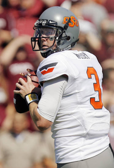 OSU's Brandon Weeden (3) looks to pass during OSU's win over Texas A&M on Saturday in College Station, Texas. Photo by Nate Billings, The Oklahoman