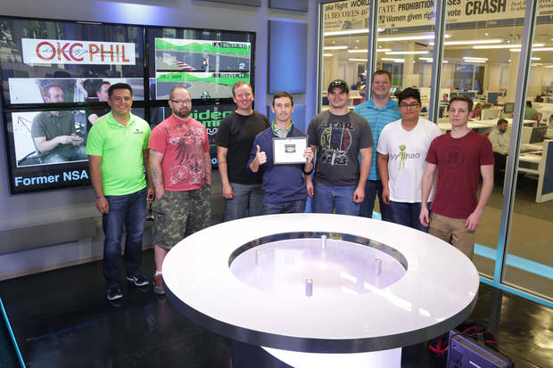 Eight of the nine participants line up for a photo after The Oklahoman Mario Kart tournament on May 15, 2015. From left: Jesus Perez, Mark Ledlow, Shaun Wright, Sean Alexander, Matt Koivisto, Justin Curry, Luke Realrider and Gage Alleman.