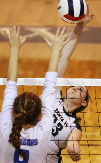 Santa Fe junior Hannah Naylor hits the ball over the arms of Stillwater's Peyton Meacham in t first round action during Stillwater vs. Edmond Santa Fe game in Class 6A volleyball tournament at Shawnee High School on Friday, Oct. 12, 2012.   Photo by Jim Beckel, The Oklahoman