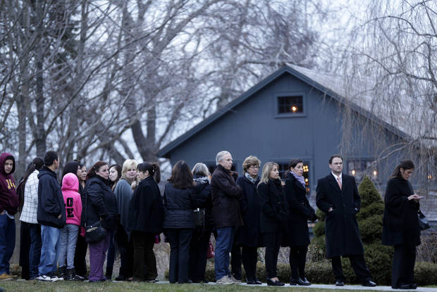 People stand in line to enter a funeral home for calling hours for Olivia Engel in Newtown, Conn., Thursday, Dec. 20, 2012. Engel, 6, was killed when Adam Lanza walked into Sandy Hook Elementary School in Newtown, Conn., Dec. 14, and opened fire, killing 26 people, including 20 children, before killing himself. (AP Photo/Seth Wenig)