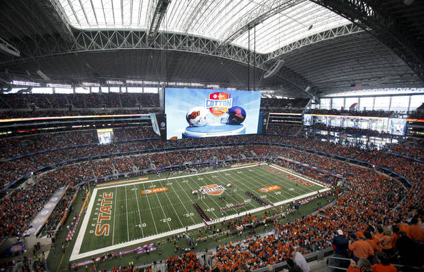 Fans cheer before the Cotton Bowl Classic college football game between the Oklahoma State University Cowboys (OSU) and the Ole Miss Rebels at Cowboys Stadium in Arlington, Texas, Saturday, January 2, 2010. Photo by Sarah Phipps, The Oklahoman