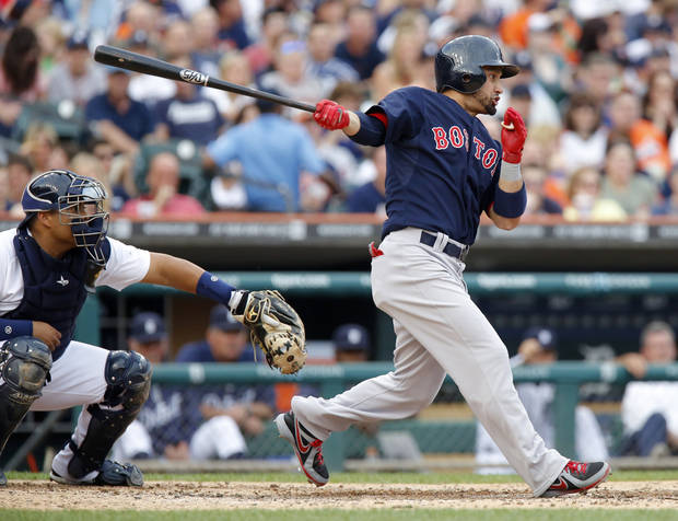 Boston Red Sox's Shane Victorino, right, singles to drive in two runs in the fourth inning as Detroit Tigers catcher Brayan Pena, left, works behind the plate during a baseball game on Friday, June 21, 2013, in Detroit. (AP Photo/Duane Burleson)