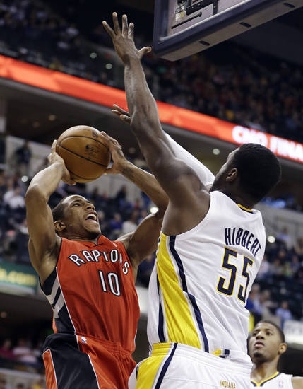 Toronto Raptors' DeMar DeRozan (10) shoots against Indiana Pacers' Roy Hibbert (55) during the first half of an NBA basketball game, Tuesday, Nov. 13, 2012, in Indianapolis. (AP Photo/Darron Cummings)
