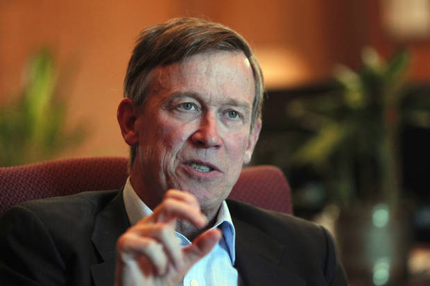 FILE - In this Dec. 12, 2012 file photo, Colorado Gov. John Hickenlooper is pictured during an interview with the Associated Press at his office in the Capitol in Denver. Hickenlooper will sign legislation Wednesday, March 20, 2013 that sets limits on ammunition magazines and expands background checks for firearms, marking a Democratic victory in a state where gun ownership is a treasured right and Second Amendment debate has played out in the wake of two mass shootings. (AP Photo/Ed Andrieski, File)