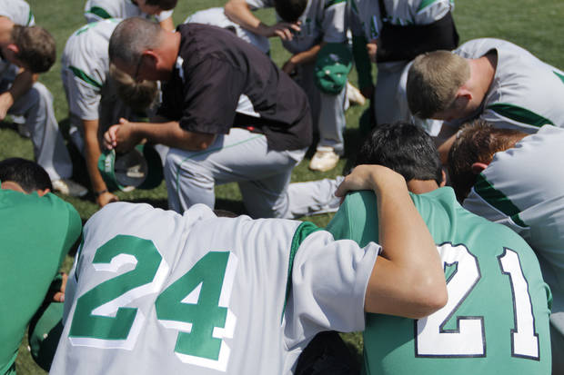 Rattan says a prayer before a Class A State Championship Baseball game between Amber-Pocasset and Rattan at Dolese Park in Oklahoma City, Saturday, May 5, 2012.  Photo by Garett Fisbeck, For The Oklahoman