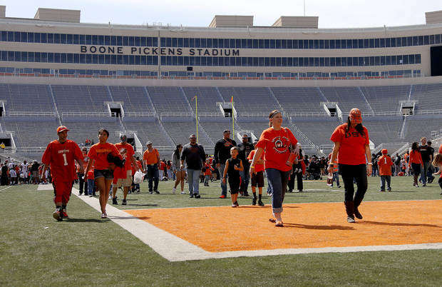Oklahoma State's fans leave the field after an autograph session following  OSU's spring football game at Boone Pickens Stadium in Stillwater, Okla., Sat., April 20, 2013. Photo by Bryan Terry, The Oklahoman