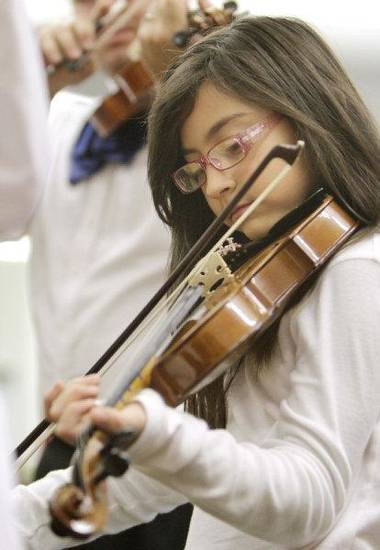 Amy Barron plays the violin during a mariachi class Tuesday at Fillmore Elementary School.