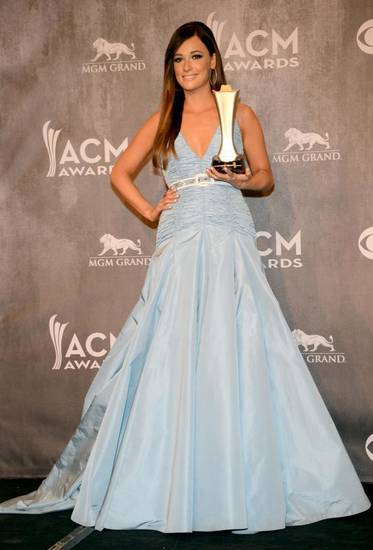 Kacey Musgraves poses in the press room with the award for album of the year at the 49th annual Academy of Country Music Awards at the MGM Grand Garden Arena on Sunday, April 6, 2014, in Las Vegas. (AP)
