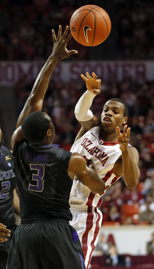 Oklahoma&#039;s Buddy Hield (3) passes the ball around Kansas State&#039;s Martavious Irving (3) during an NCAA men&#039;s basketball game between the University of Oklahoma (OU) and Kansas State at the Lloyd Noble Center in Norman, Okla., Saturday, Feb. 2, 2013. Photo by Nate Billings, The Oklahoman