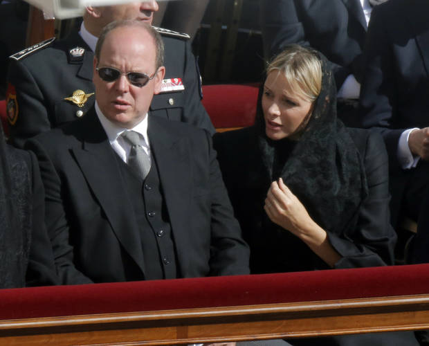 Prince Albert of Monaco and his wife Charlene attend Pope Francis' inaugural Mass, in St. Peter's Square at the Vatican, Tuesday, March 19, 2013. (AP Photo/Dmitry Lovetsky)