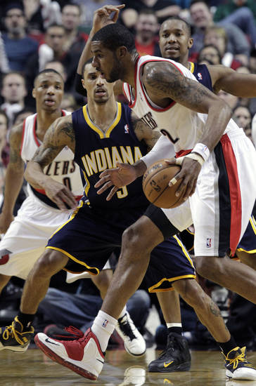 Portland Trail Blazers forward LaMarcus Aldridge, right, drives past Indiana Pacers guard George Hill during the second half of an NBA basketball game in Portland, Ore., Wednesday, Jan. 23, 2013.  Aldridge scored 27 points as the Trail Blazers won 100-80.(AP Photo/Don Ryan)