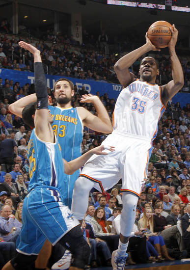 Oklahoma City Thunder's Kevin Durant (35) shoots over New Orleans Hornets' Austin Rivers (25) during the NBA basketball game between the Oklahoma CIty Thunder and the New Orleans Hornets at the Chesapeake Energy Arena on Wednesday, Dec. 12, 2012, in Oklahoma City, Okla.   Photo by Chris Landsberger, The Oklahoman